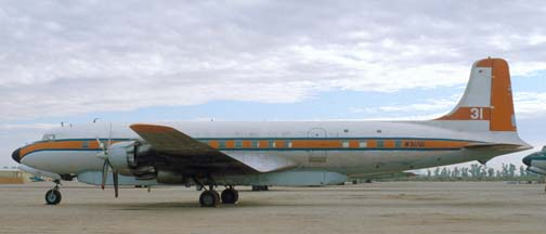 Douglas DC-7B, N51701 Tanker 31 at the Gila Bend Indian Reservation Memorial Airport on December 30, 1981