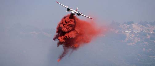Tankers fight the Camino Fire on the crest of the Santa Ynez Mountains, August 15, 2002