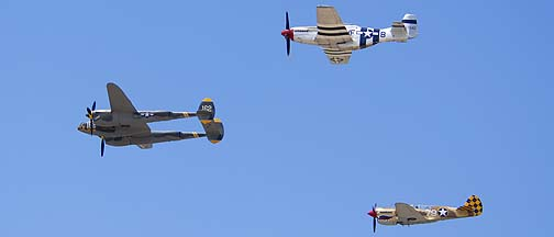 Curtiss P-40N Warhawk NL85104, P-38J Lightning NX138AM 23 Skidoo, and P-51D Mustang NL5441V Spam Can