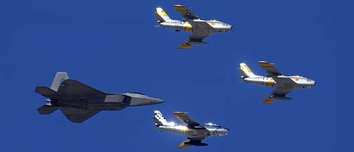 Lockheed-Martin F-22A Raptor 04-4068, North American F-86F Sabre N186AM, F-86E NX1F Hell er Bust, and F-86F N860AG., Davis-Monthan Air Force Base, March 4, 2012