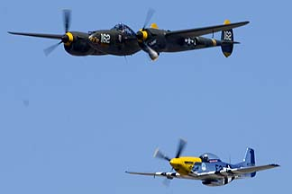 Lockheed P-38J Lightning NX138AM 23 Skidoo and North American P-51D Mustang N5444V Miss Kandy, August 17, 2013