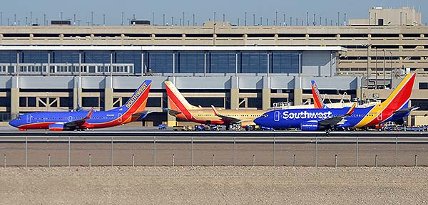 Southwest Boeing 737-7H4s N244WN and N711HK and 737-790 N560WN, Phoenix Sky Harbor, December 22, 2014