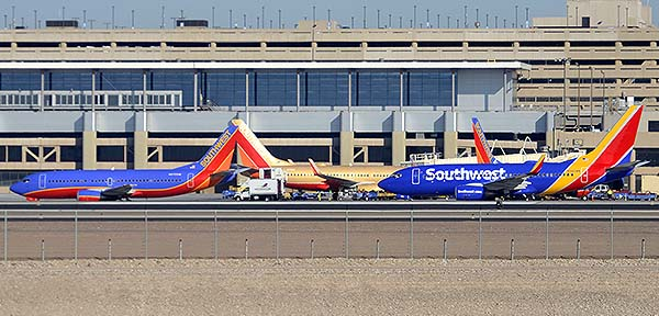 Southwest Boeing 737-3G7 N670SW, 737-7H4 N711HK, and 737-790 N560WN, Phoenix Sky Harbor, December 22, 2014